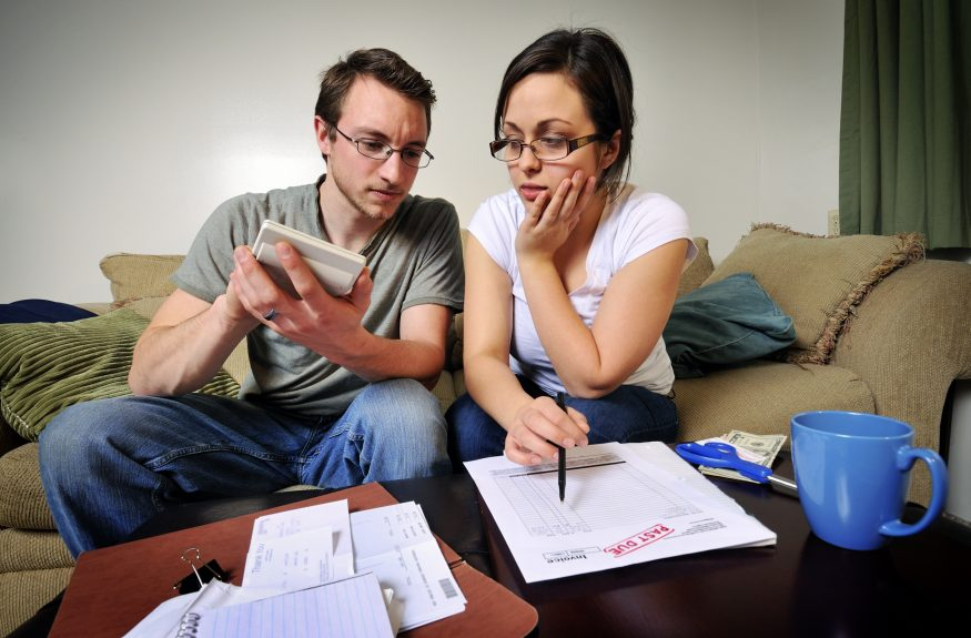 young couple debating bankruptcy